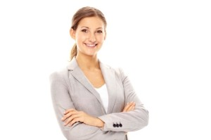 Smiling businesswoman looking at camera in isolation